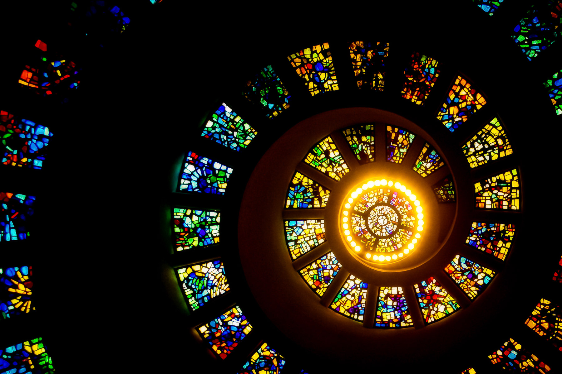 The stained-glass window on the ceiling of the chapel at Thanks-Giving Square in Downtown Dallas.