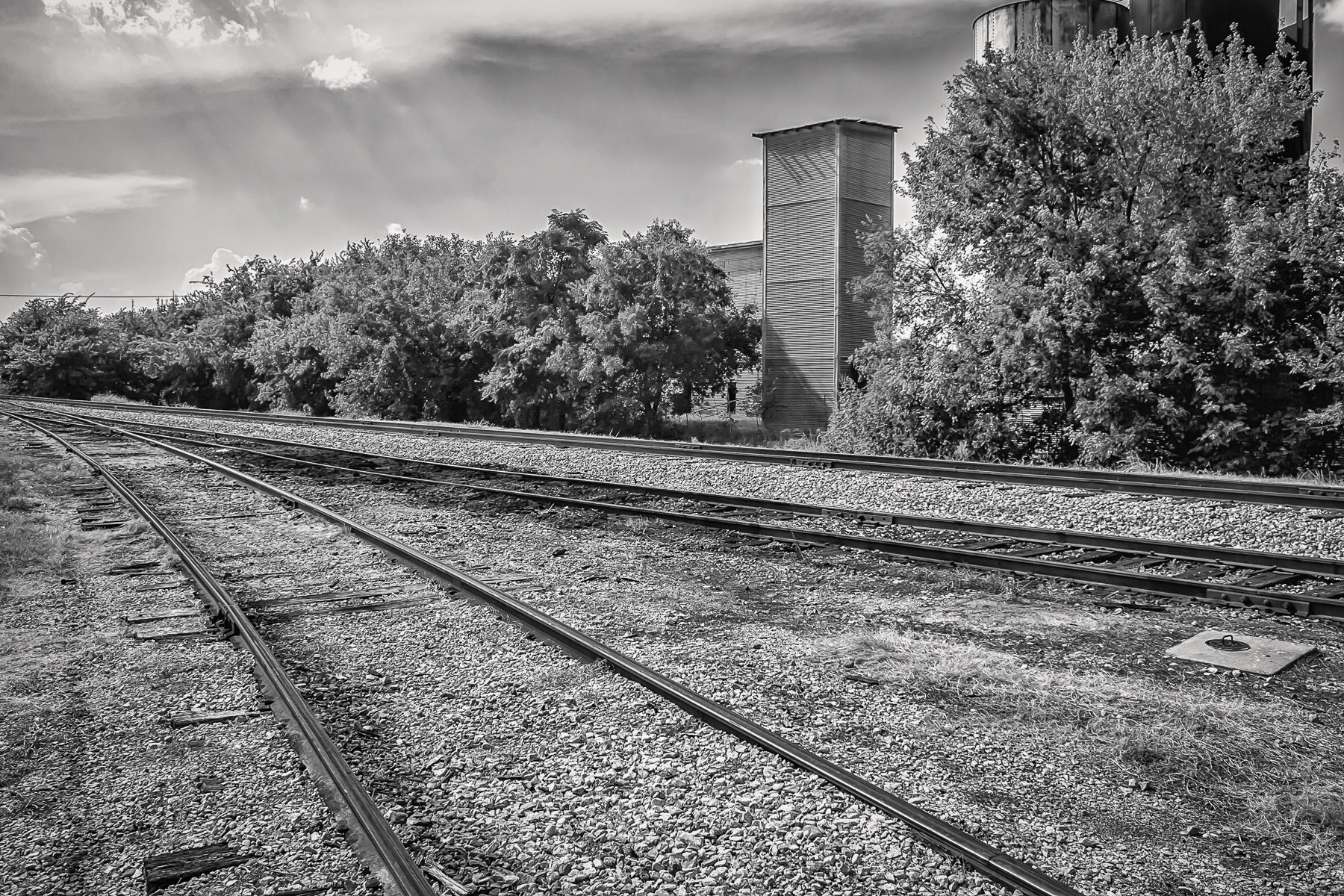 Railroad tracks, receding westward down the line from Grapevine, Texas.