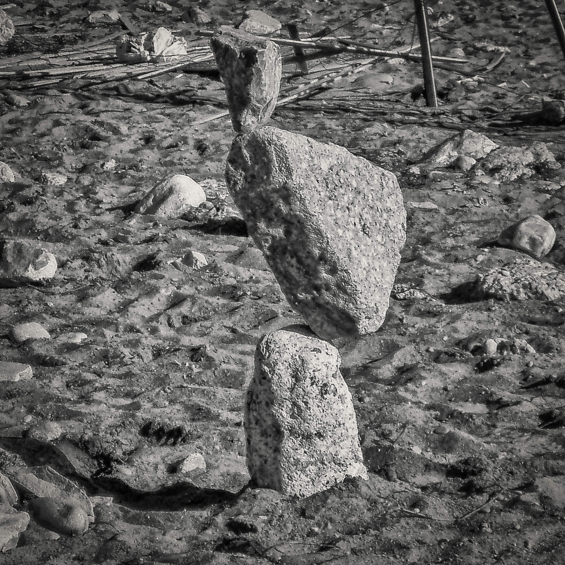 Rocks meticulously balanced in the sand at The Beaches, Toronto.