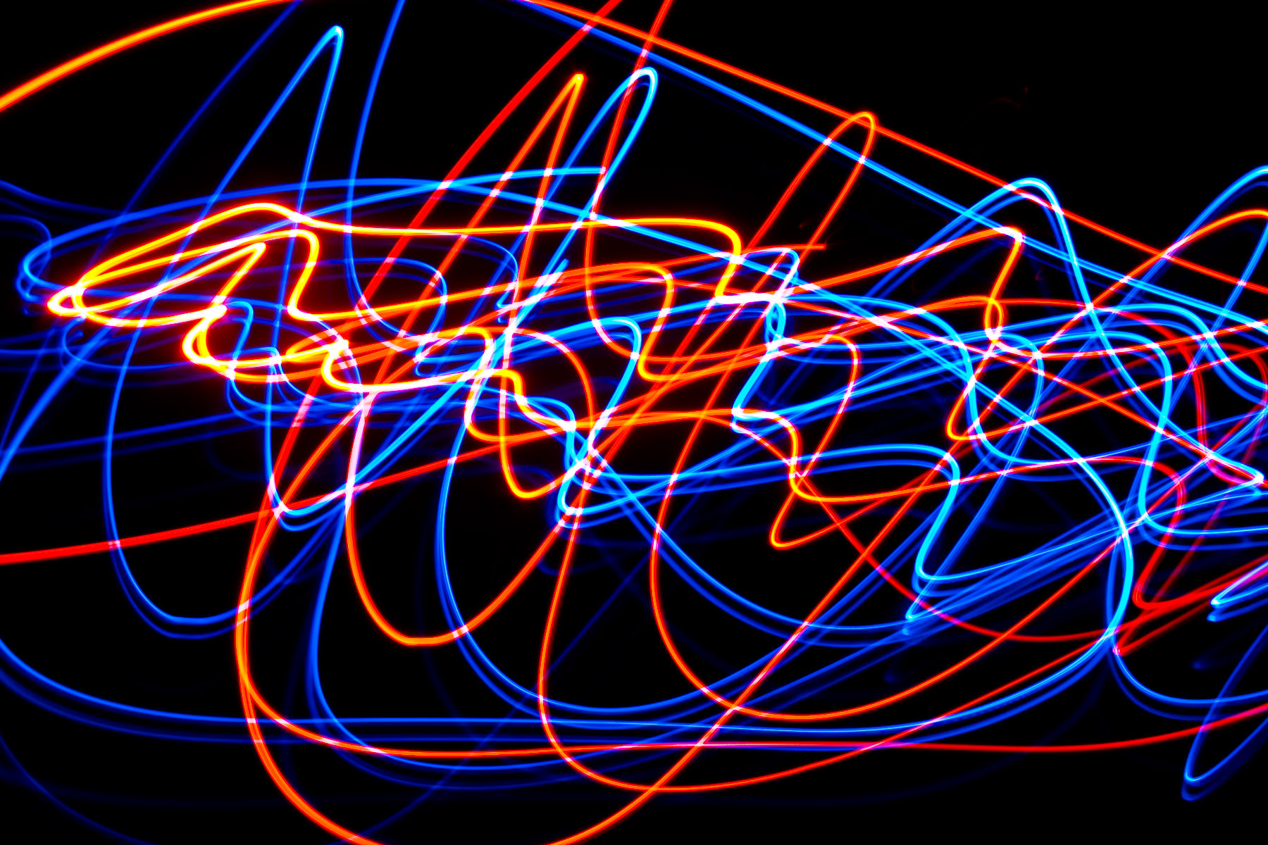 I was playing around with LEDs, a candle, a dark room and long exposures again and came up with this.
