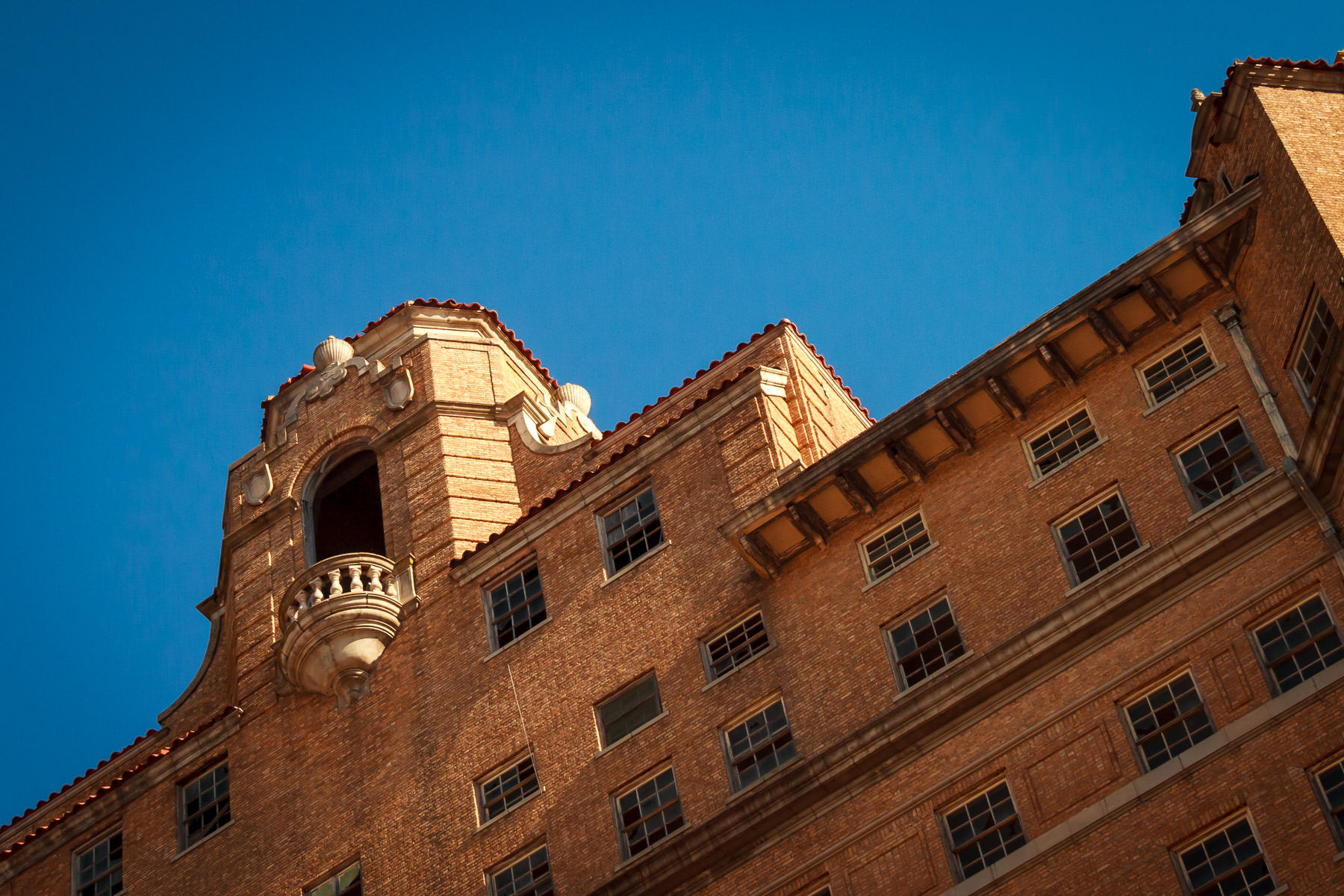 The long-abandoned Baker Hotel in Mineral Wells rises into the clear blue Texas sky.