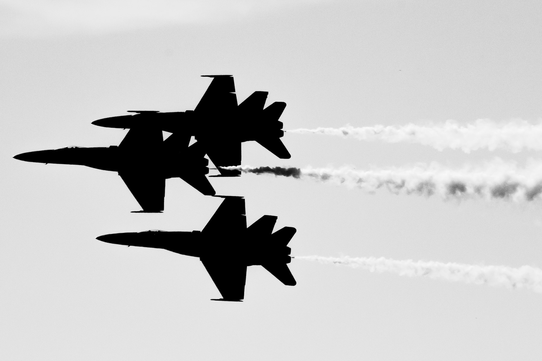 The U.S. Navy's Blue Angels at the Fort Worth-Alliance Air Show, silhouetted against the sky.