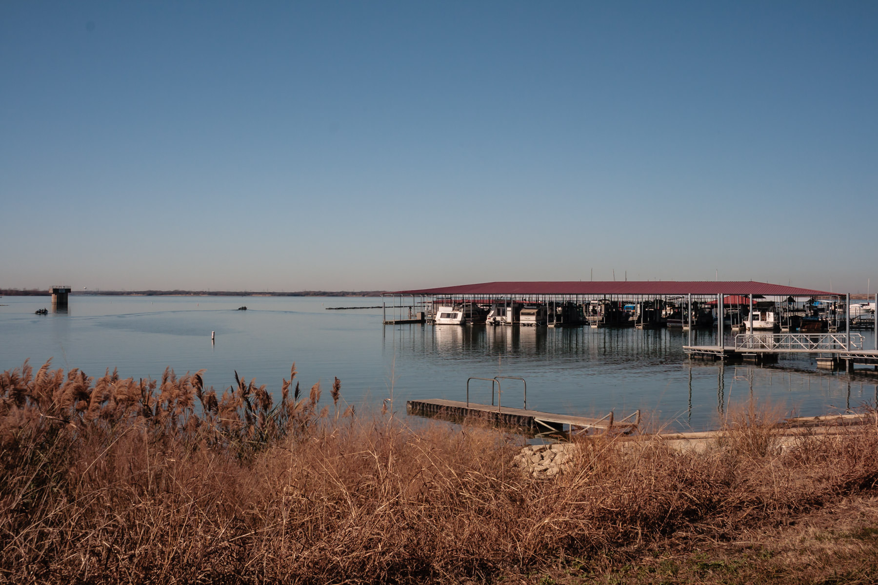 A marina on Joe Pool Lake in Cedar Hill, Texas, on a clear winter morning.