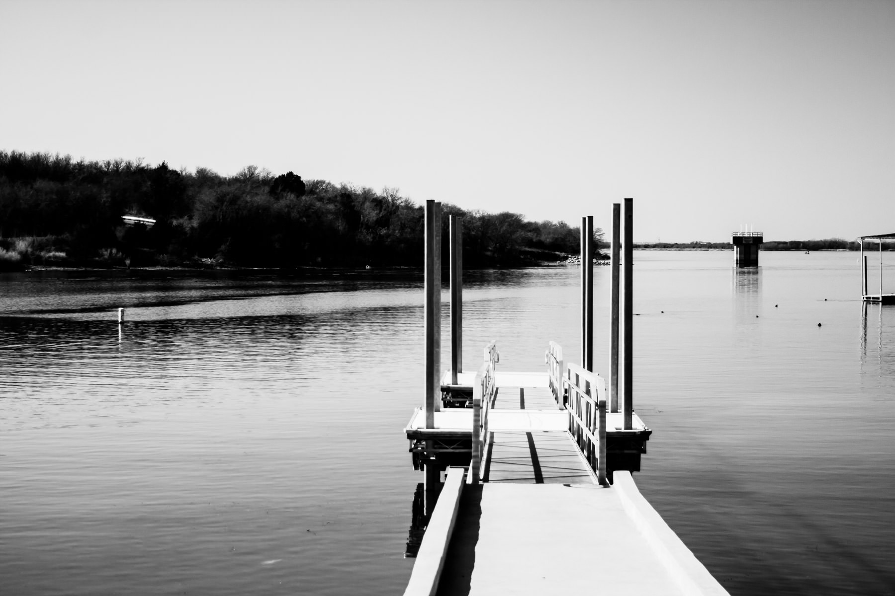 A pier reaches into Joe Pool Lake near Cedar Hill, Texas.