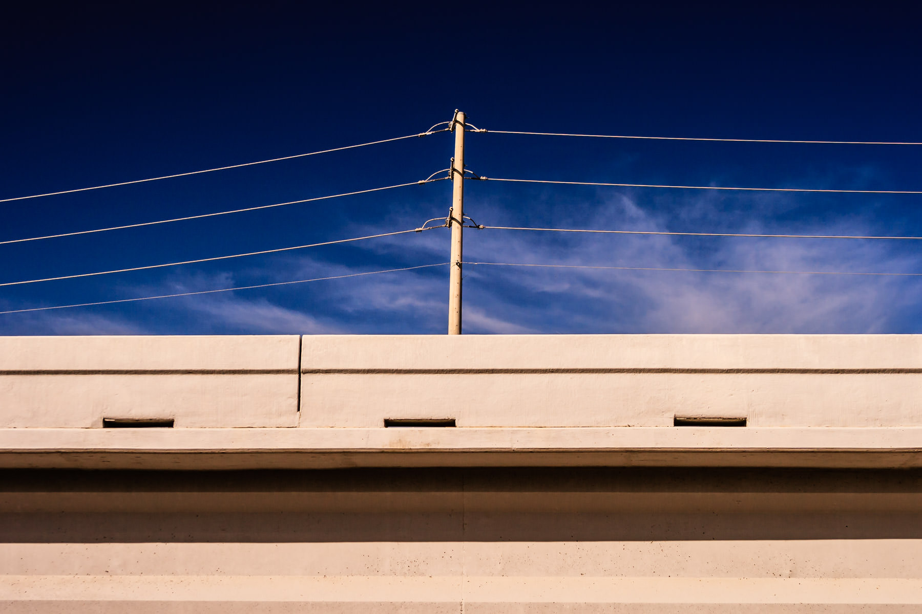Power lines over a bridge somewhere in Allen, Texas.