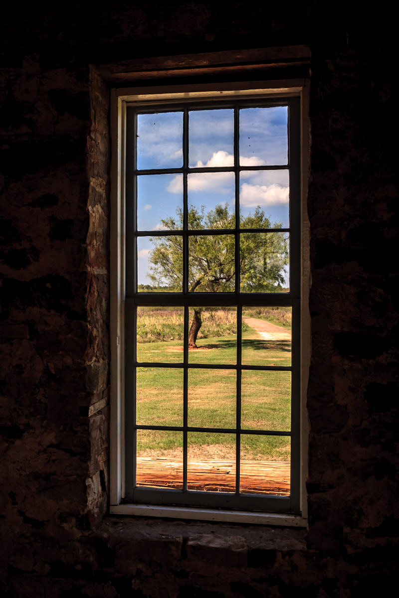 A tree seen through a window at Fort Richardson, Jacksboro, Texas.