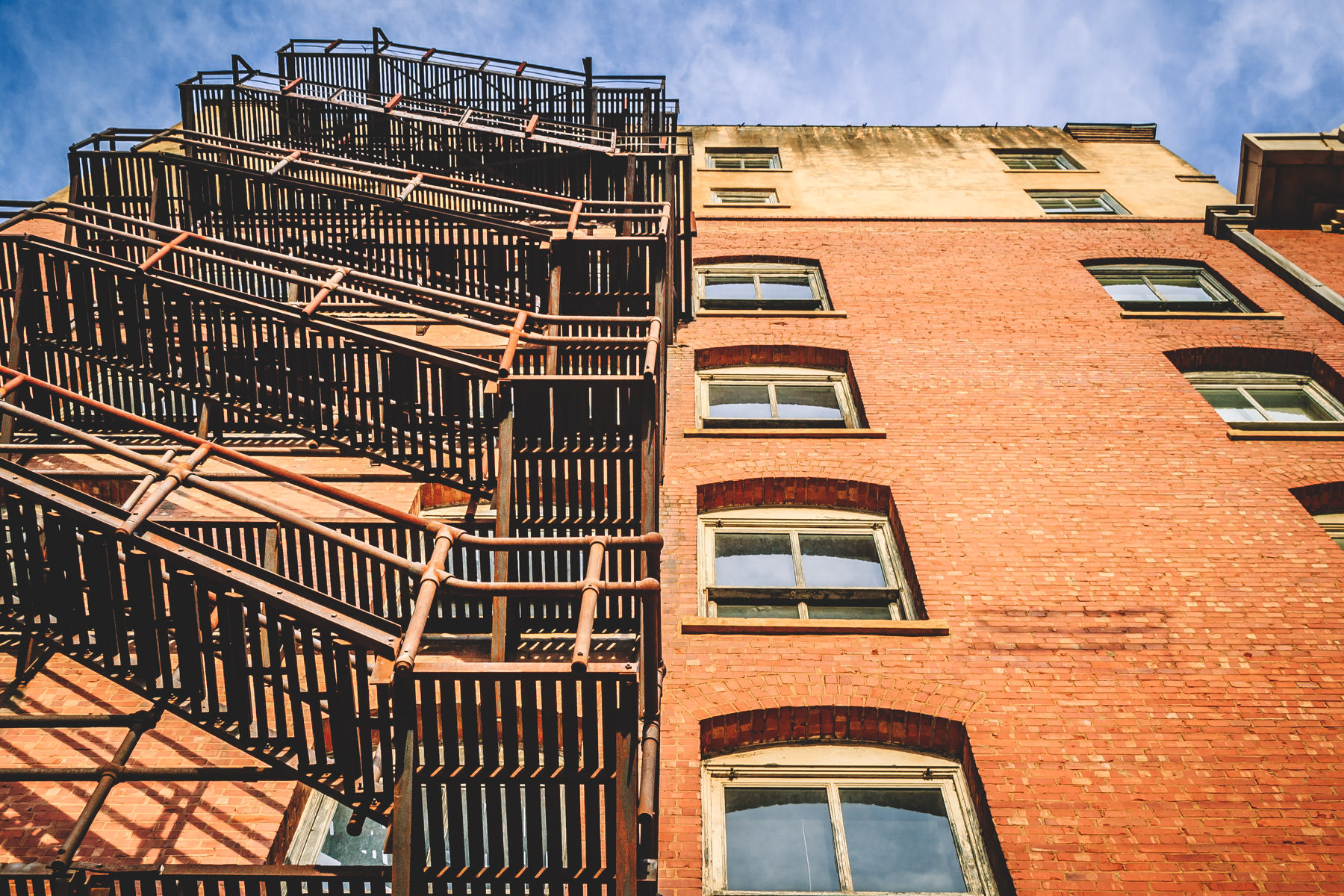 A fire escape climbs up the side of an old building in Downtown Wichita Falls, Texas.