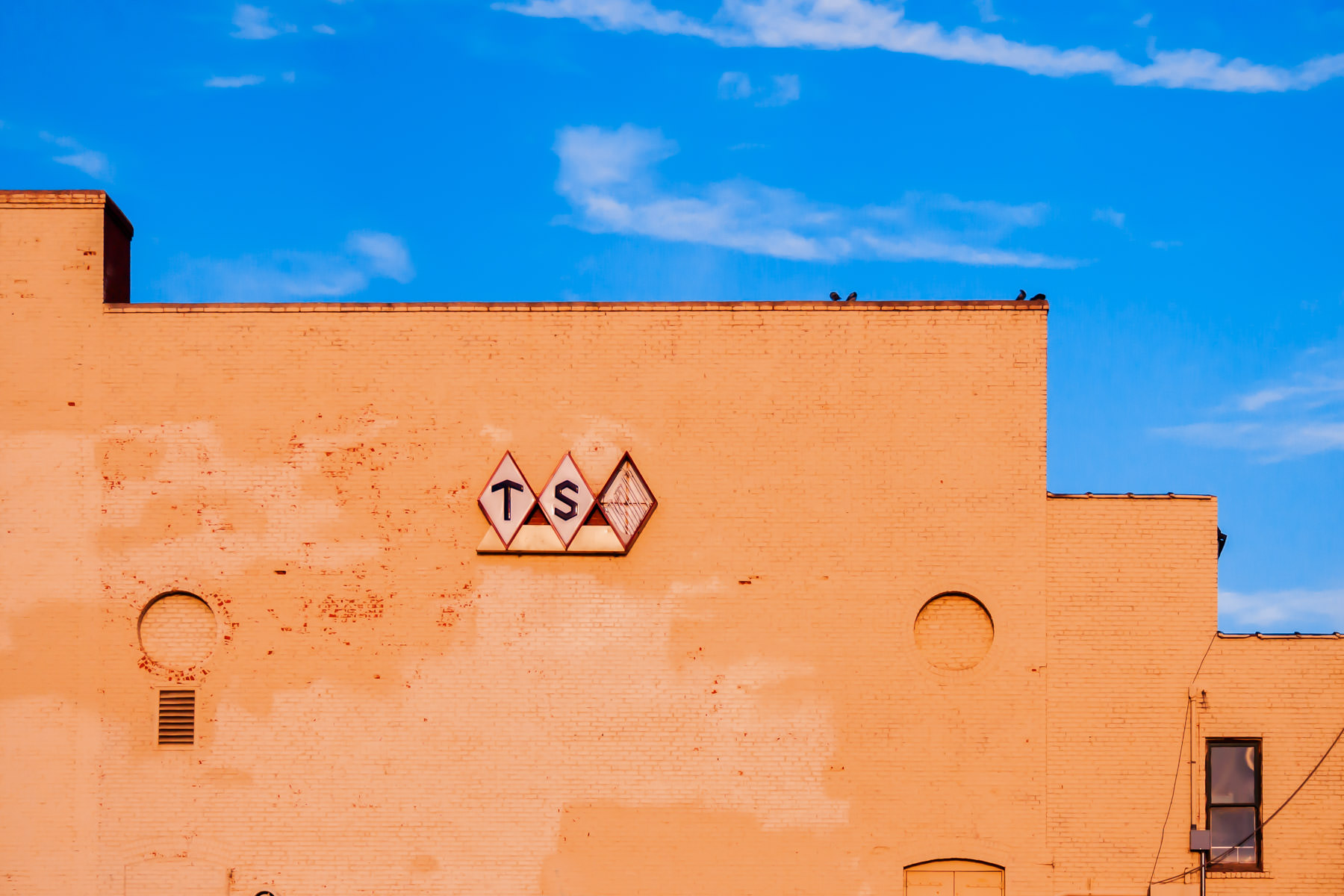 "A decaying Texas State Optical (missing the ""O"") in Downtown Wichita Falls, Texas."