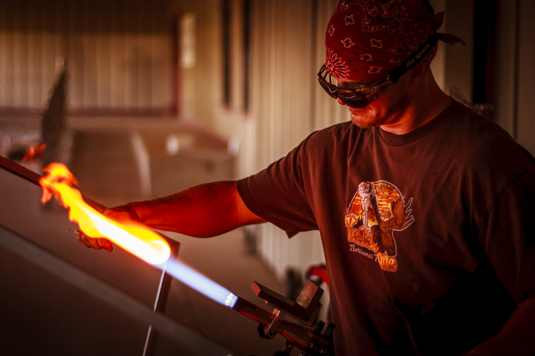 An artisan shapes molten glass at the Vetro Glass Studio in Grapevine, Texas.
