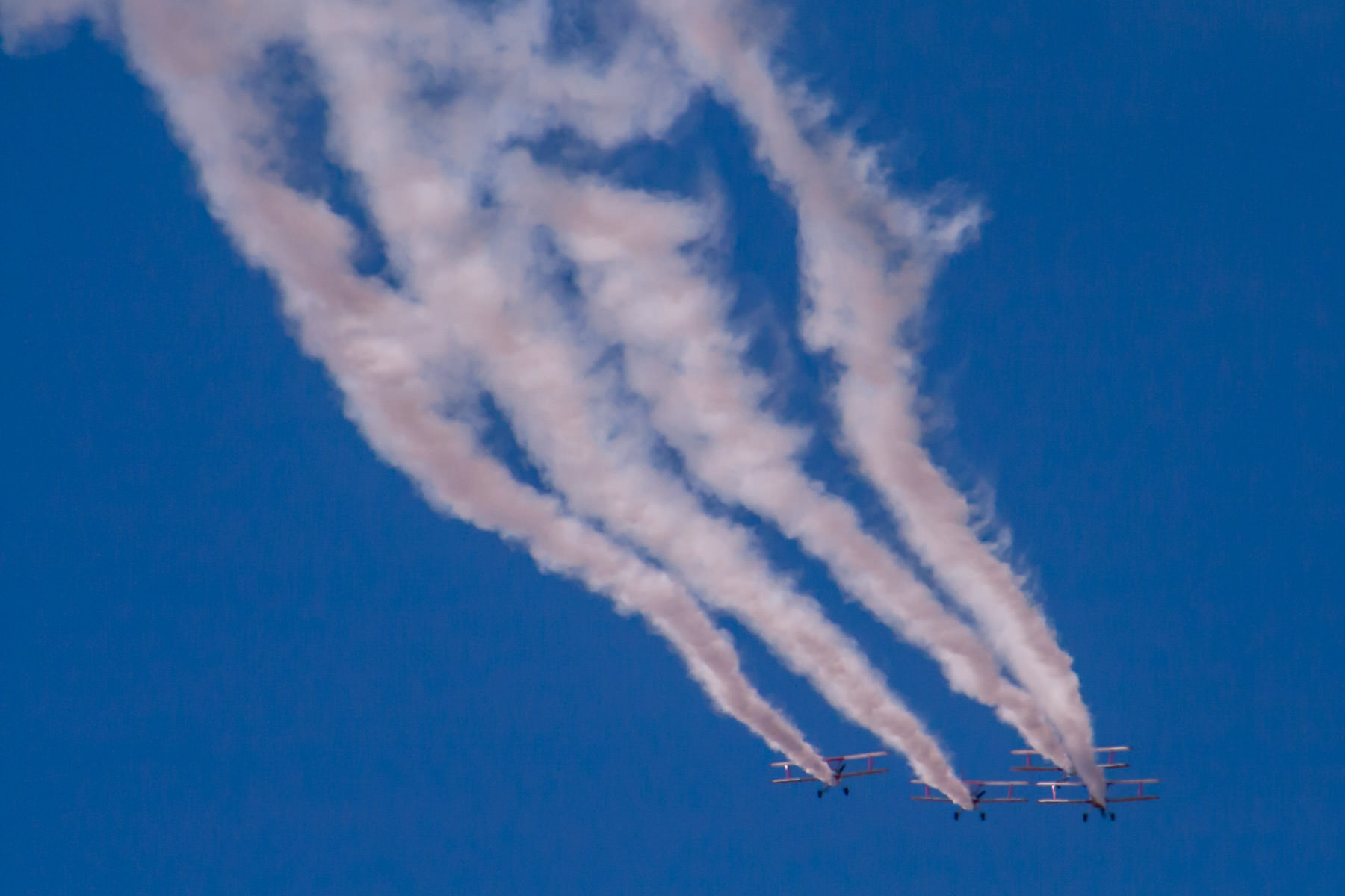 Biplanes leave smoke trails at the Fort Worth-Alliance Air Show.
