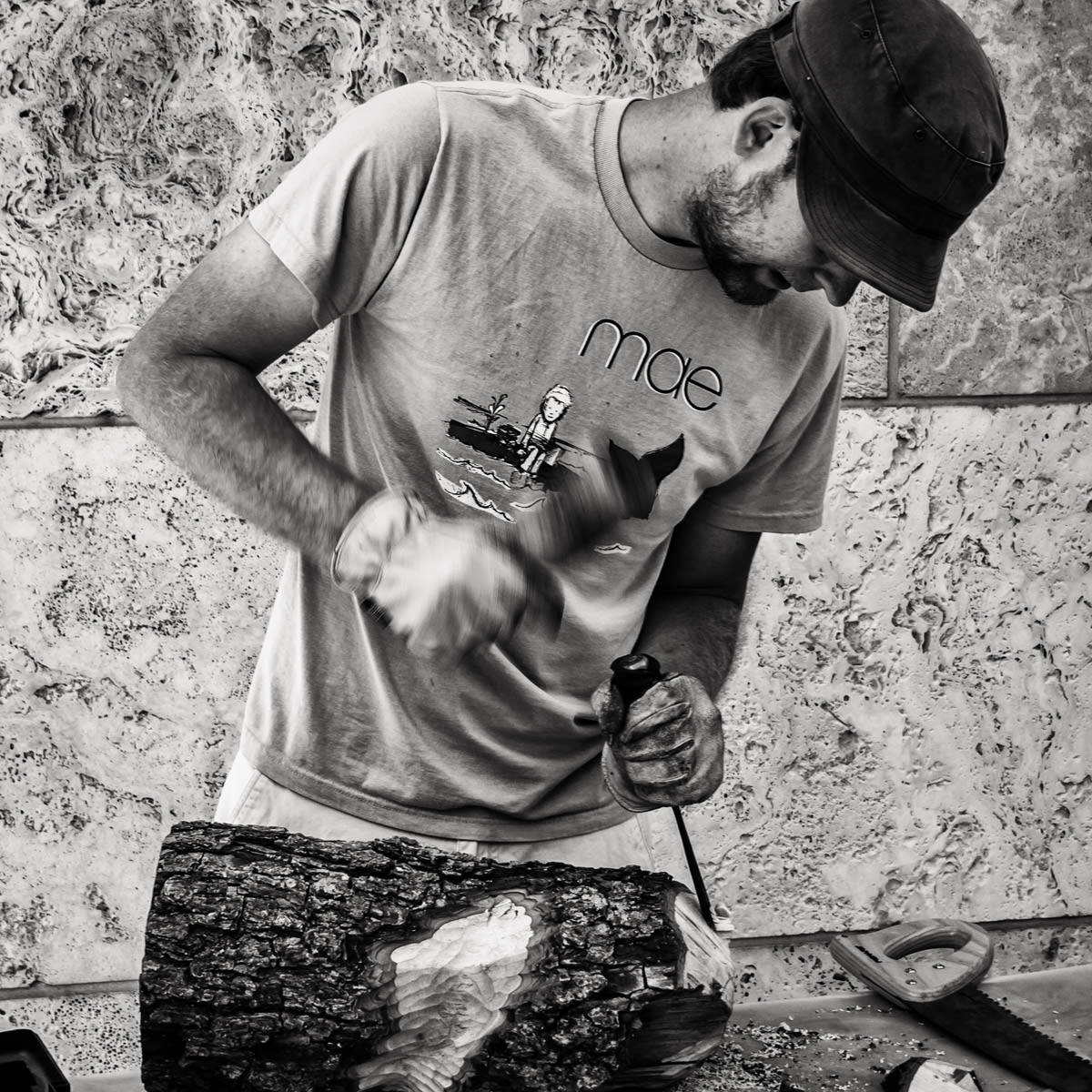 An artisan works on a carving at the Dallas City Arts Festival.