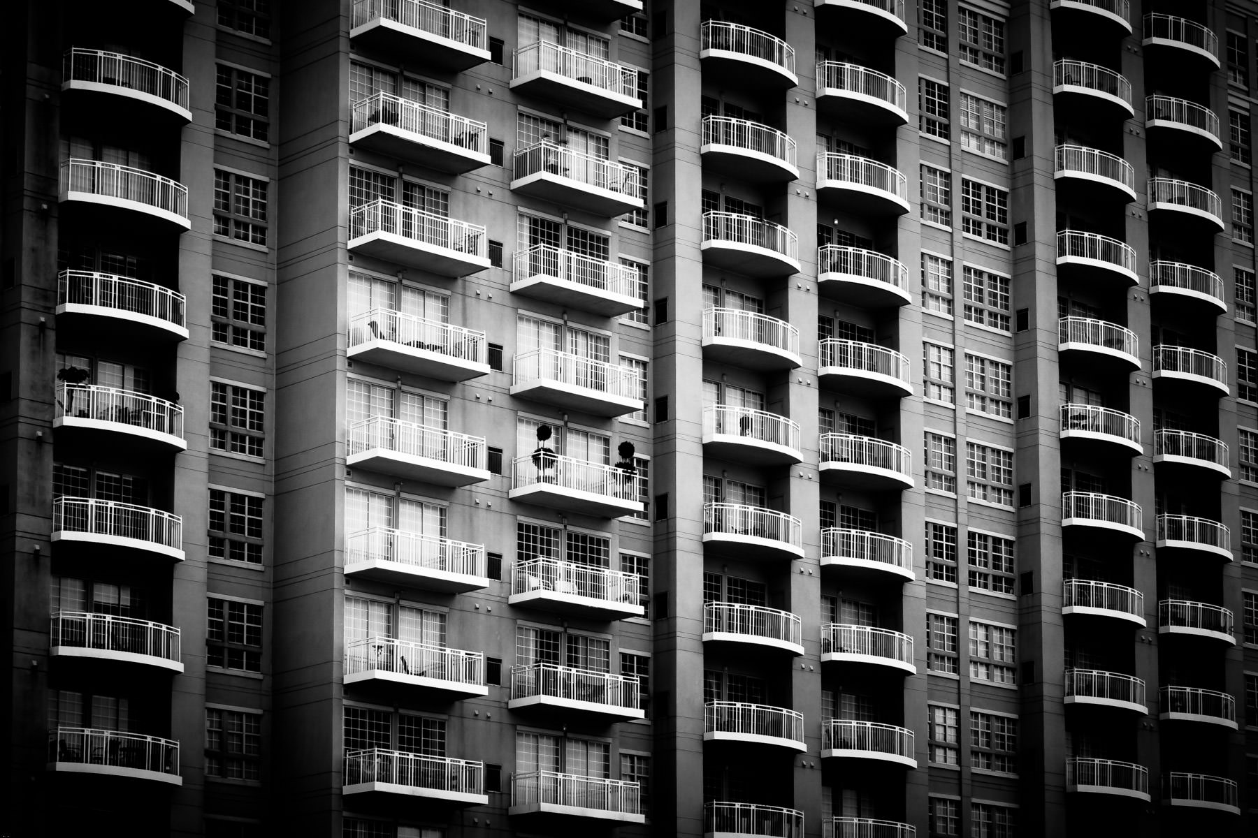 Balconies on a condo tower in Uptown Dallas, overlooking Lee Park.