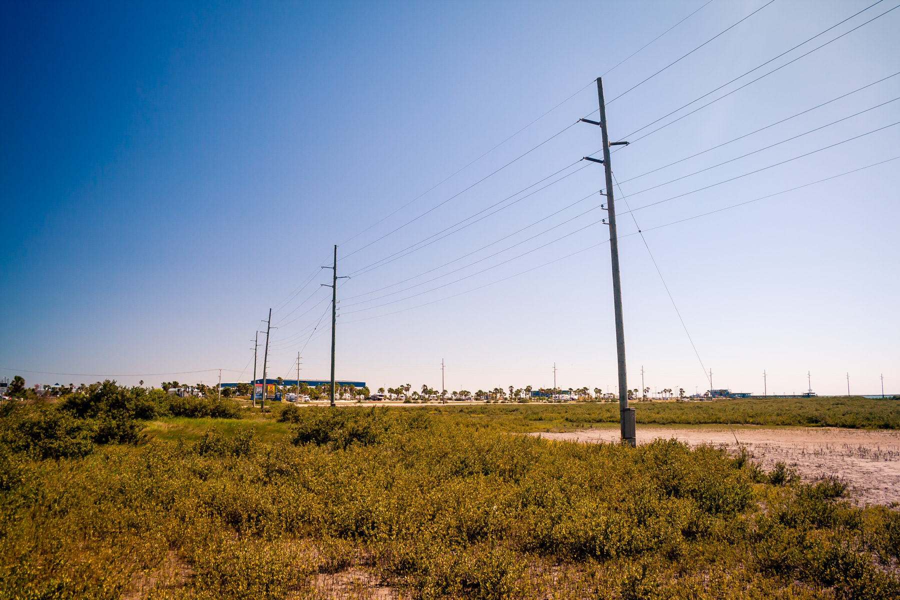 Power lines lead to a lonely convenience store on South Padre Island, Texas.