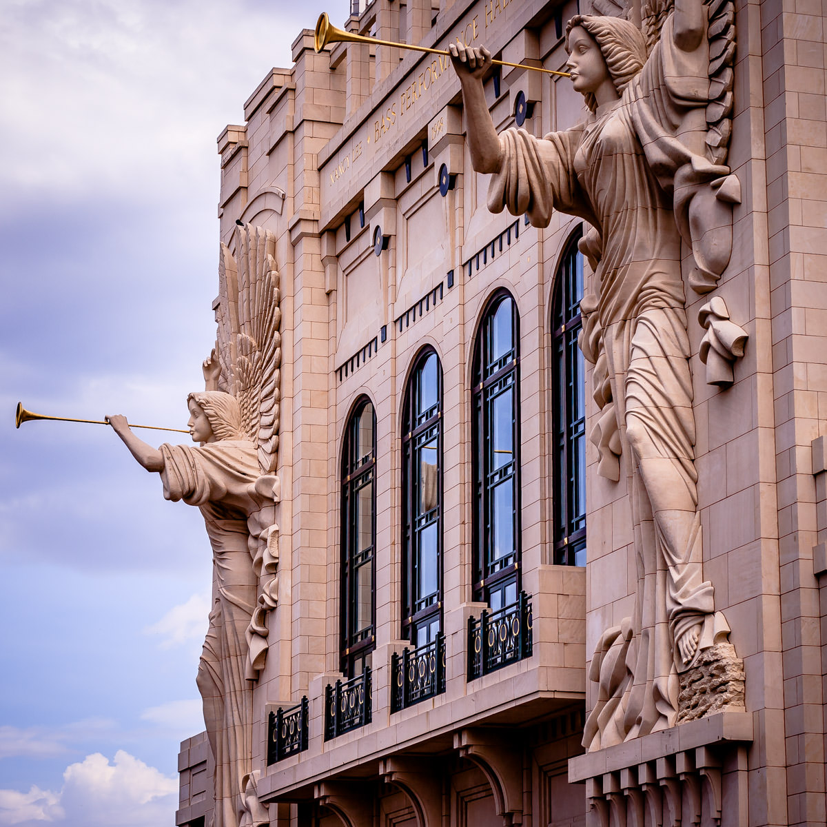 Two 48-foot-tall angels on the Grand Facade of Bass Performance Hall in Fort Worth, Texas, sculpted by Marton Varo.