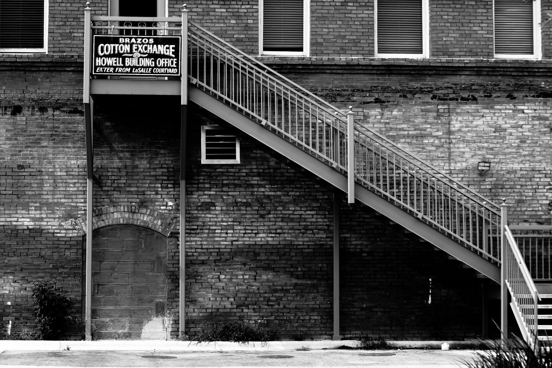 Stairs leading to the back entrance of the Brazos Cotton Exchange, Bryan, Texas.