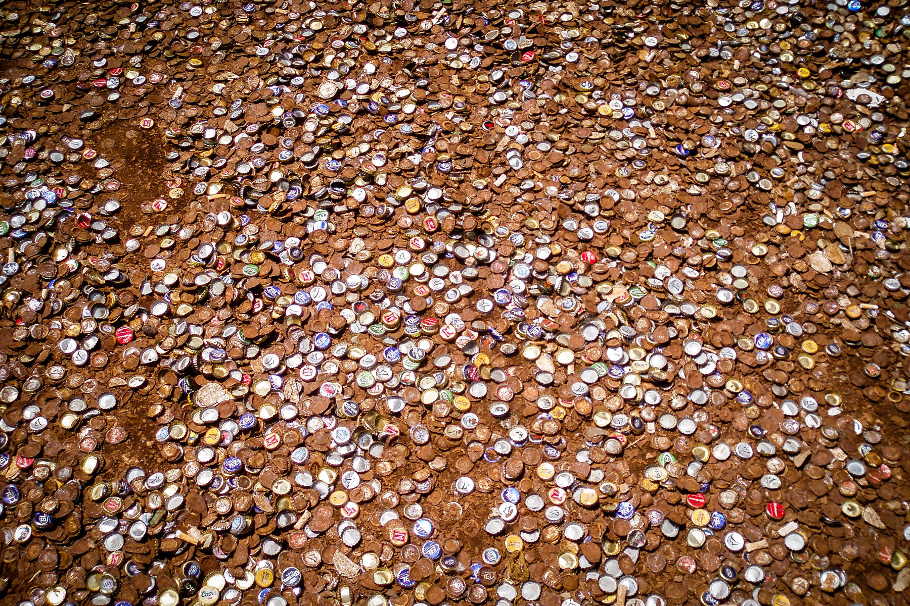 Thousands of rusting bottle caps litter the alley between the Dixie Chicken and the Dry Bean Saloon in College Station, Texas.