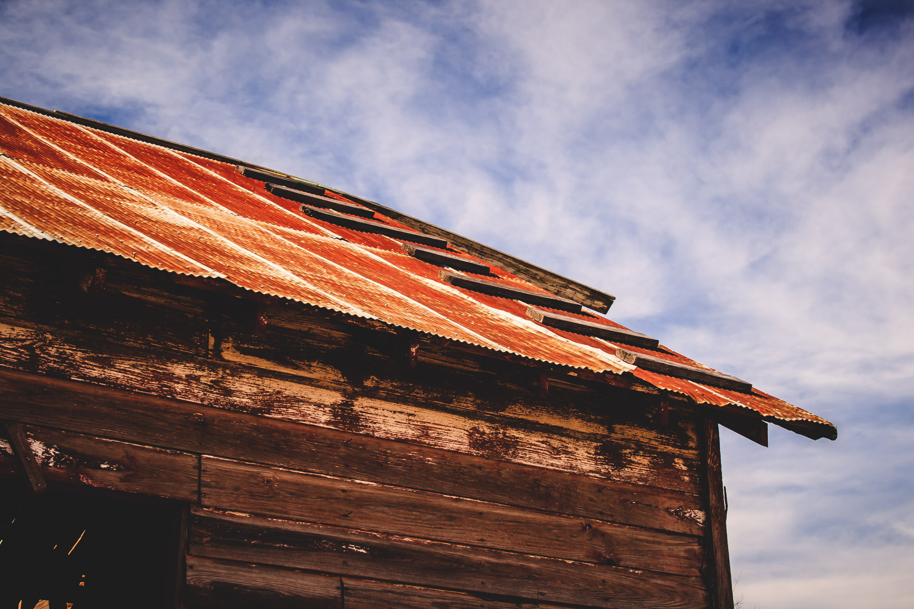 A corrugated metal roof rusts atop an old barn near Allen, Texas.