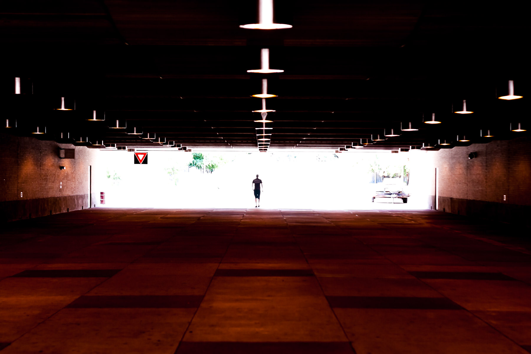 A lone figure traverses the tunnel under Wellborn Road from Texas A&M University's Main Campus to its West Campus.