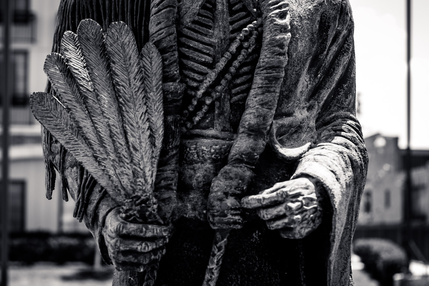 Detail of a statue on a Native American in Fort Worth, Texas' Stockyards Historical District.
