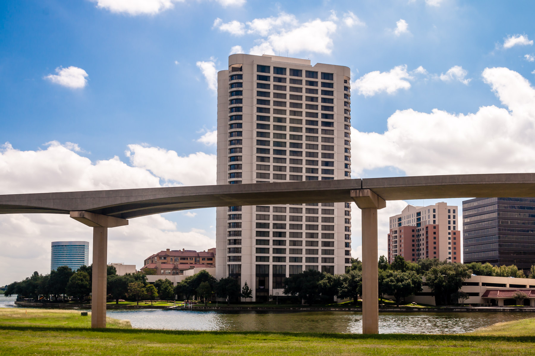 The railway for the Las Colinas people mover snakes past the Omni Mandalay Hotel in Irving, Texas.
