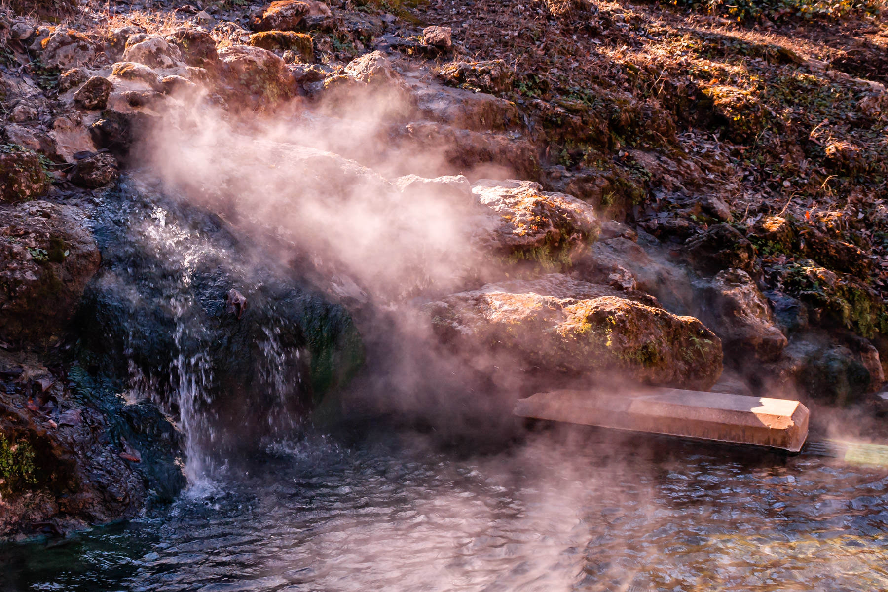 Steam pours from a hot spring in the aptly-named Hot Springs, Arkansas.