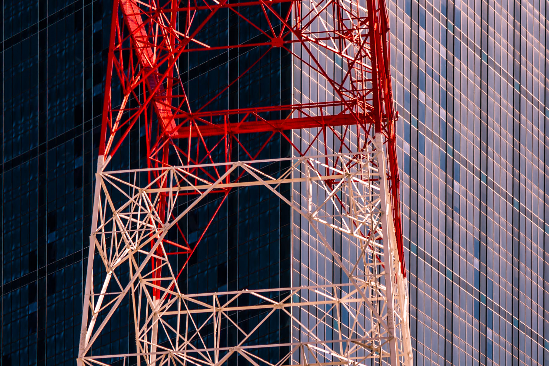 A communications tower stands next to Renaissance Tower in Downtown Dallas, Texas.