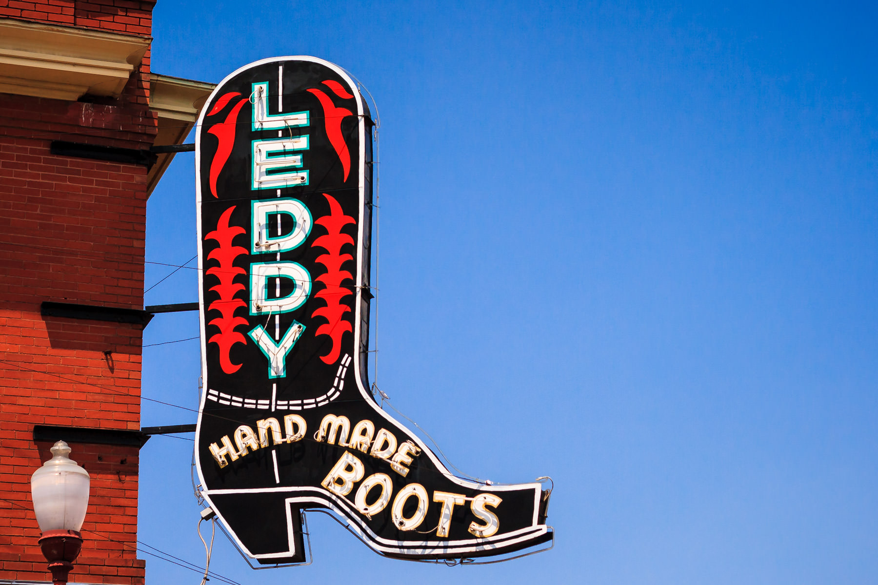 The boot-shaped sign for M.L. Leddy's boot shop in the Fort Worth Stockyards.