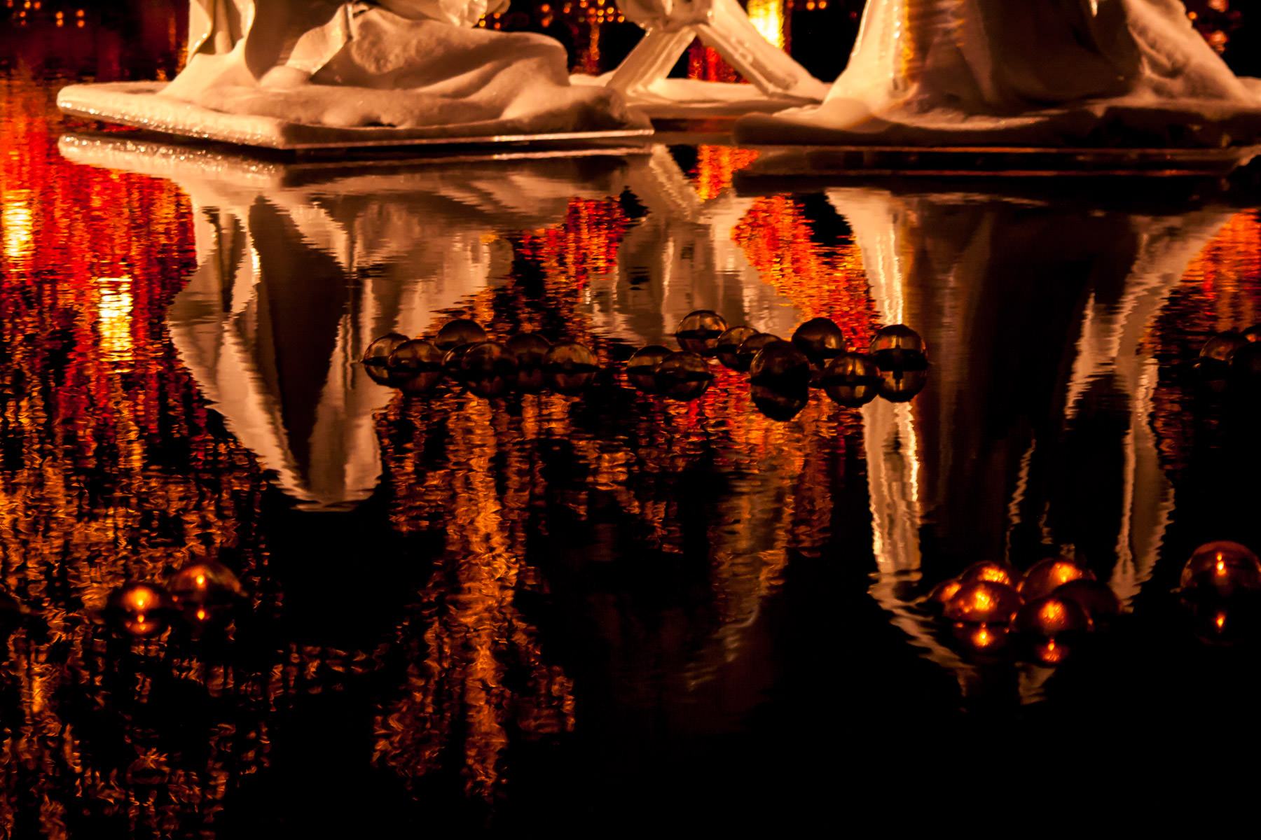 Religious statues reflected in a fountain's water at Temple Square, Salt Lake City, Utah.