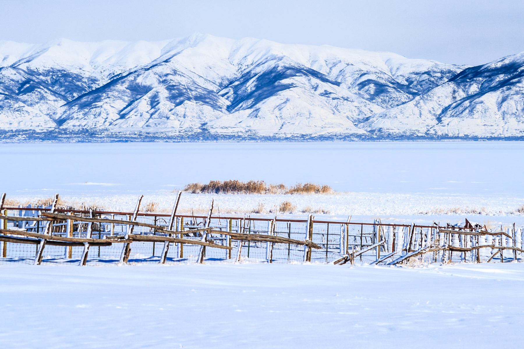 A fence at the Fielding Garr Ranch on Antelope Island, Utah, backed by the mighty Wasatch Front.