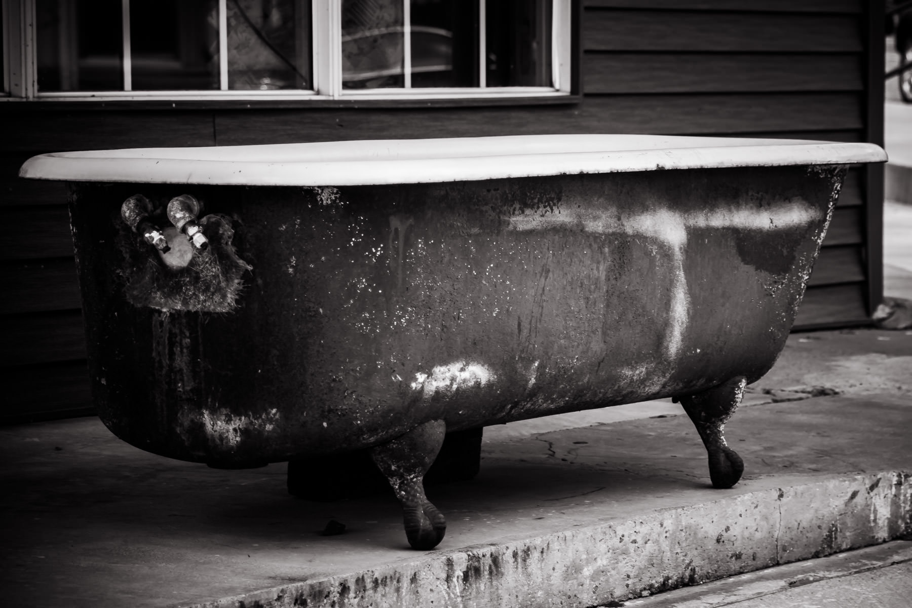 An old bathtub in front of an antiques store in Gladewater, Texas.