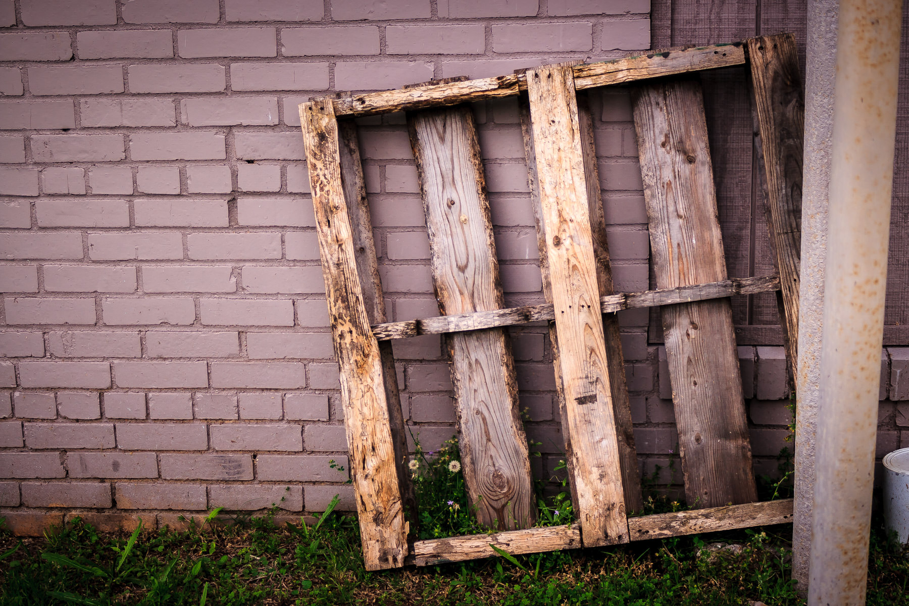 An old pallet, discarded behind a building in Gladewater, Texas.