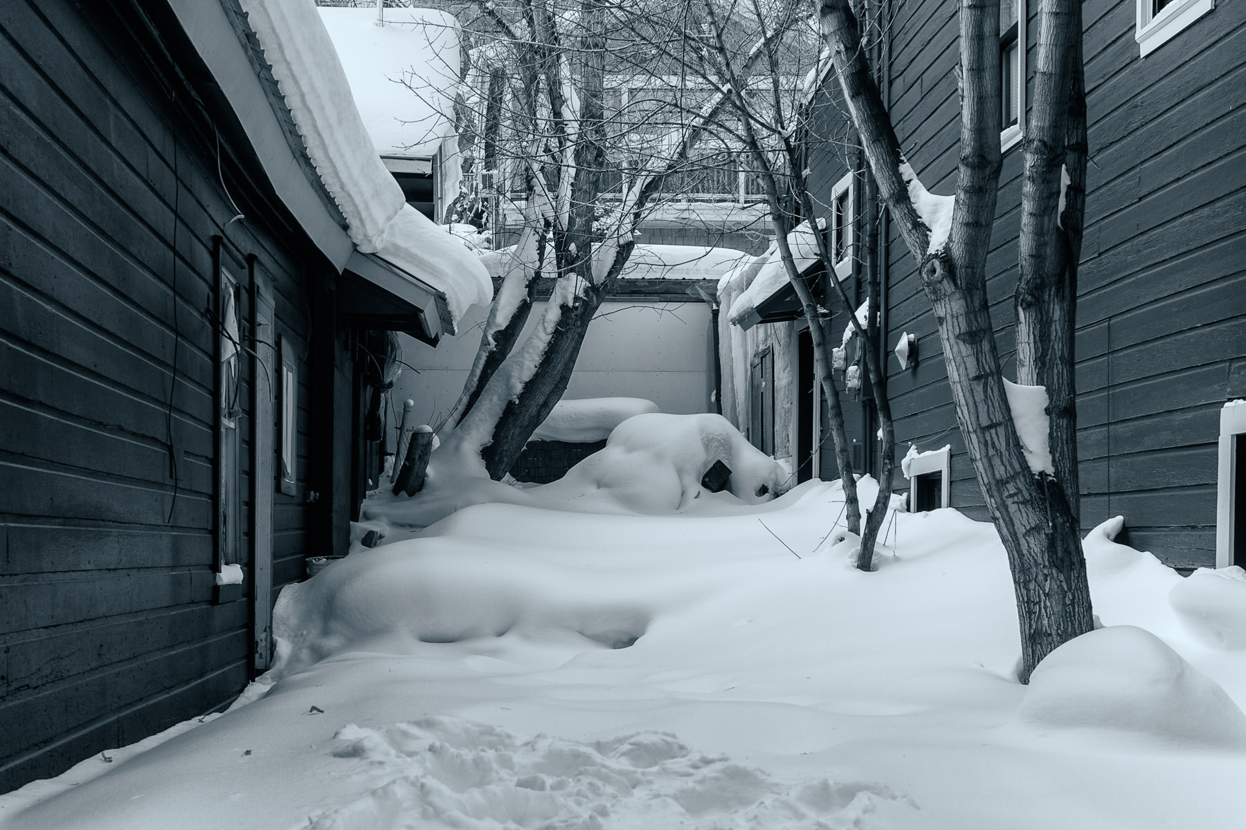 Snow fills the spaces between houses in Park City, Utah.