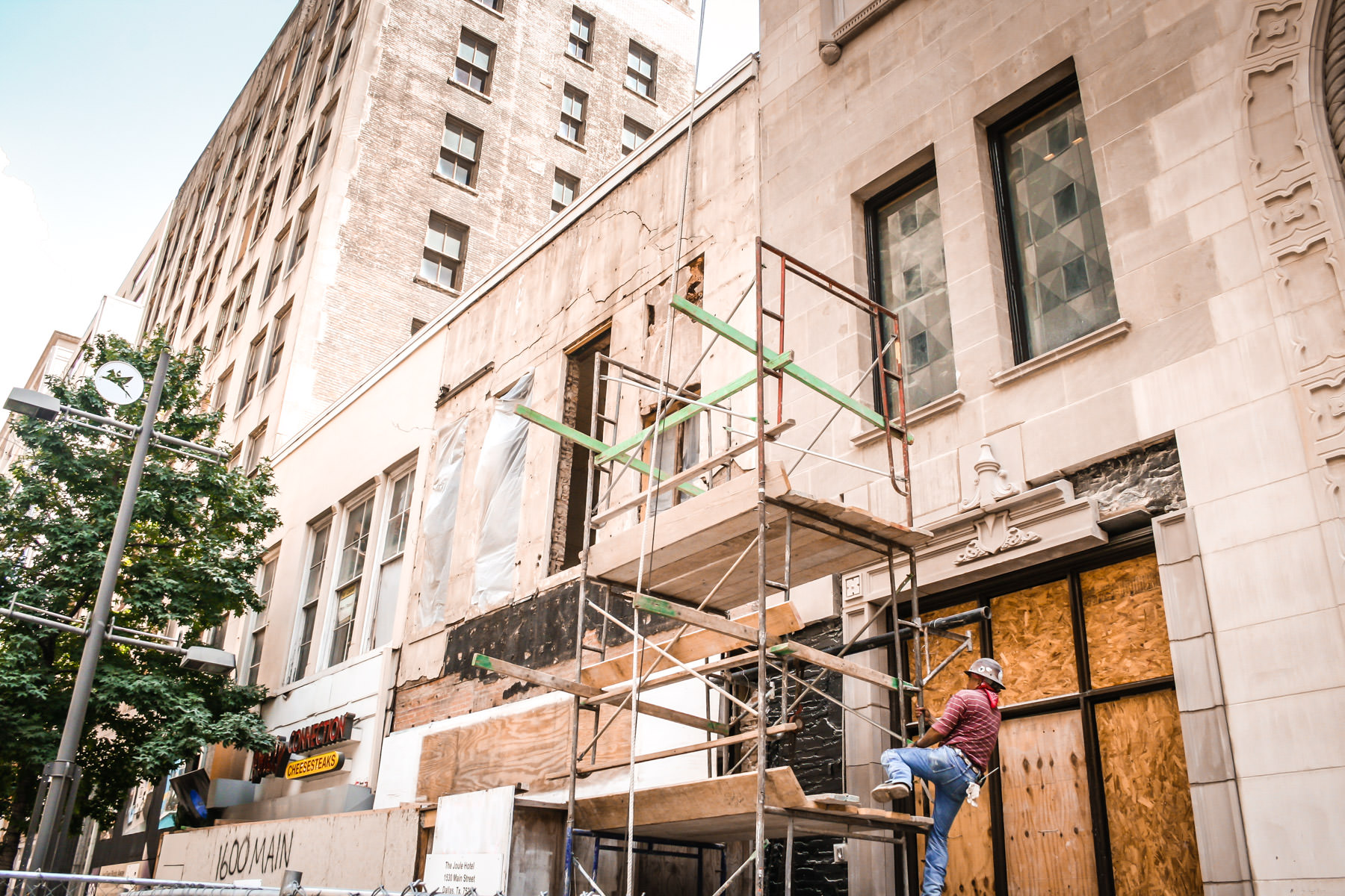 A workman scales a scaffold in downtown Dallas, Texas.