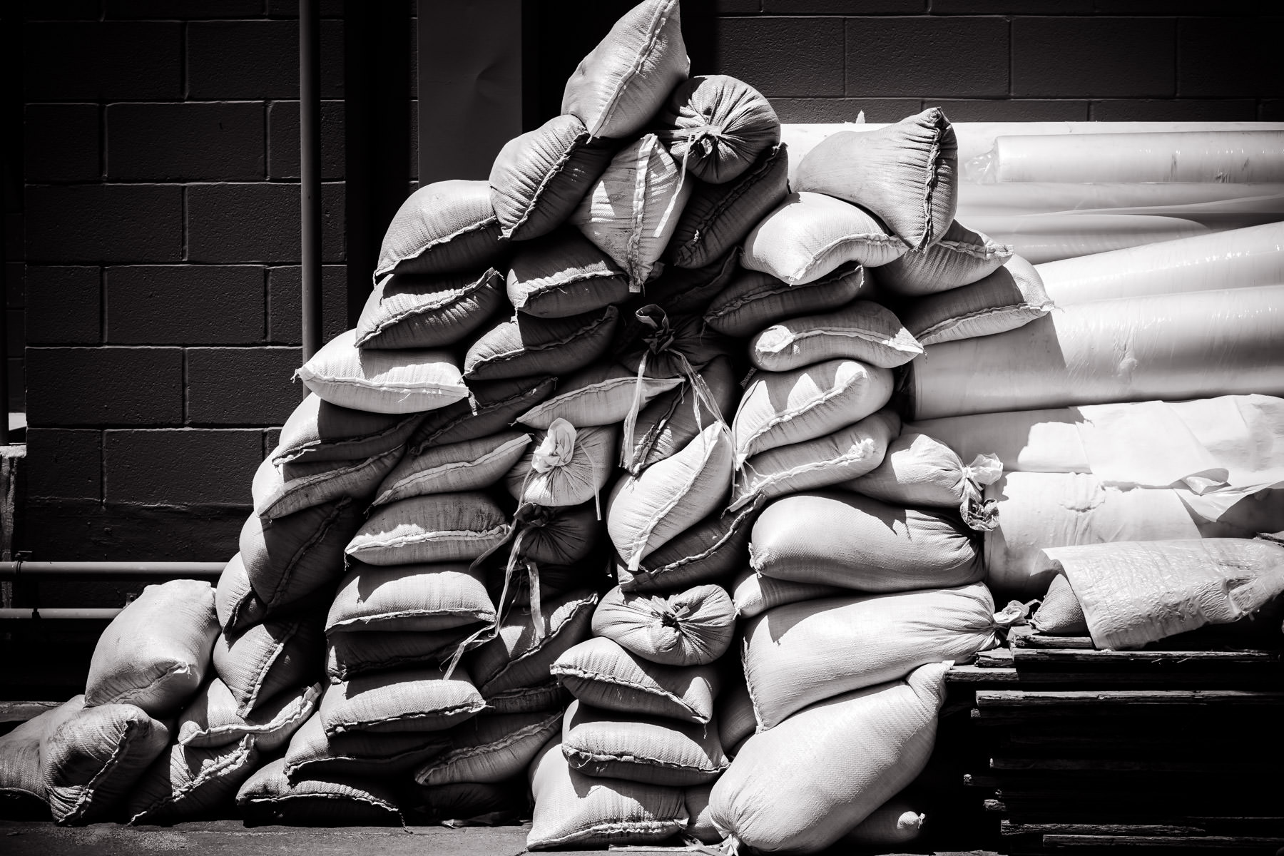 Sacks stacked behind a local strip mall in Dallas, Texas.