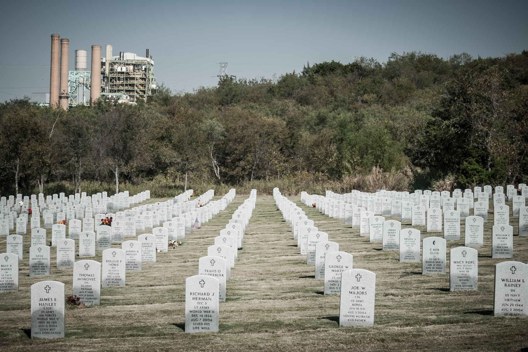TXU's Mountain Creek Power Plant looms over Dallas National Cemetery.