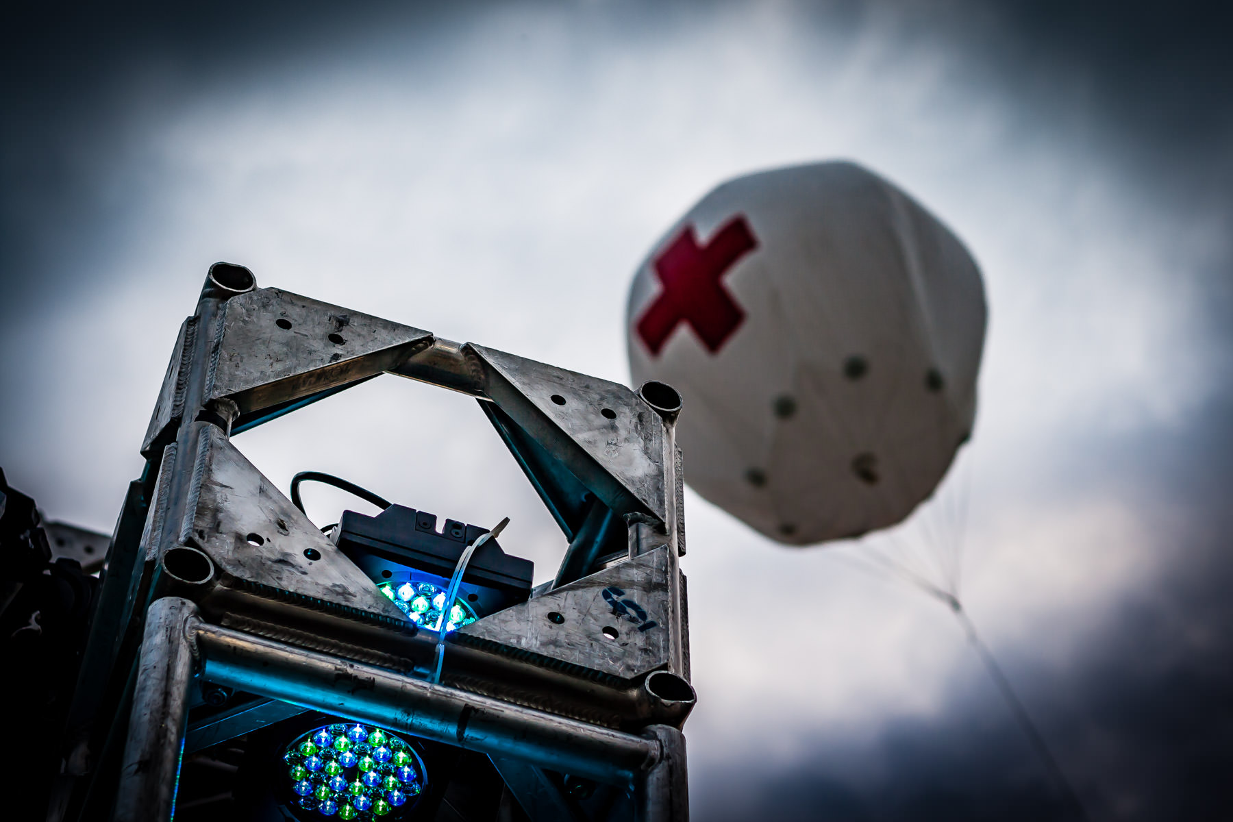 A lighting truss and a balloon marking the first aid station at the Plano Balloon Festival, Texas.