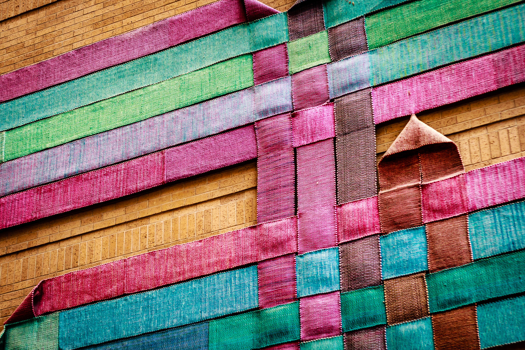 Textiles decorate the walls of the atrium in Texas A&M University's Horticulture and Forest Science Building.