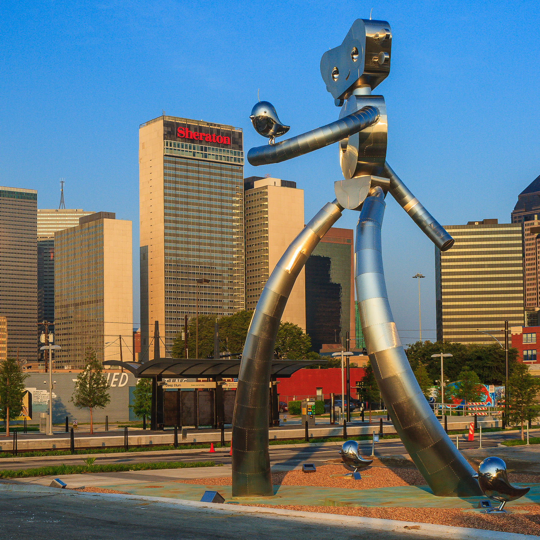 The 38-foot-tall, 35,000 lb. Traveling Man sculpture at DART's Deep Ellum Station in Dallas.