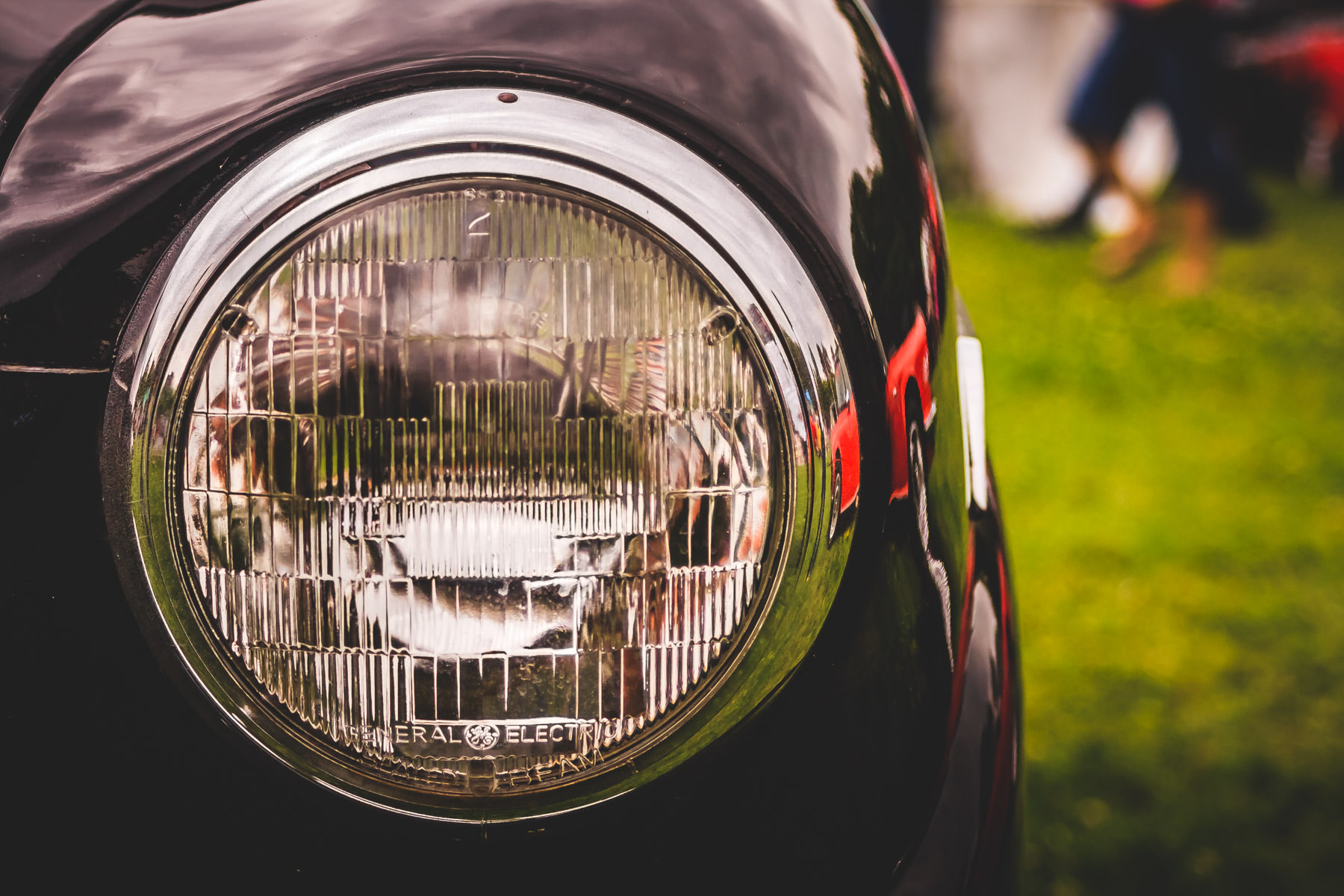 A General Electric headlight on a classic Triumph at Dallas' All British Car Day.