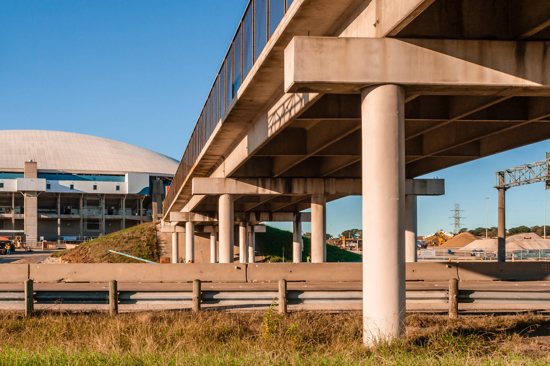 This pedestrian bridge crosses a busy road to the soon-to-be-demolished Texas Stadium.