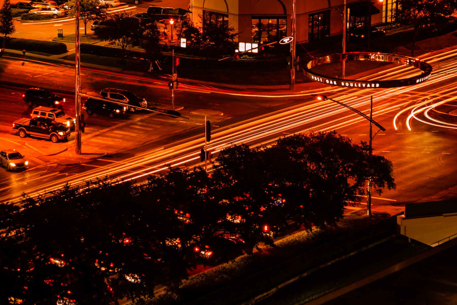 A long exposure shot of the busy Houston intersection of Post Oak and Westheimer.