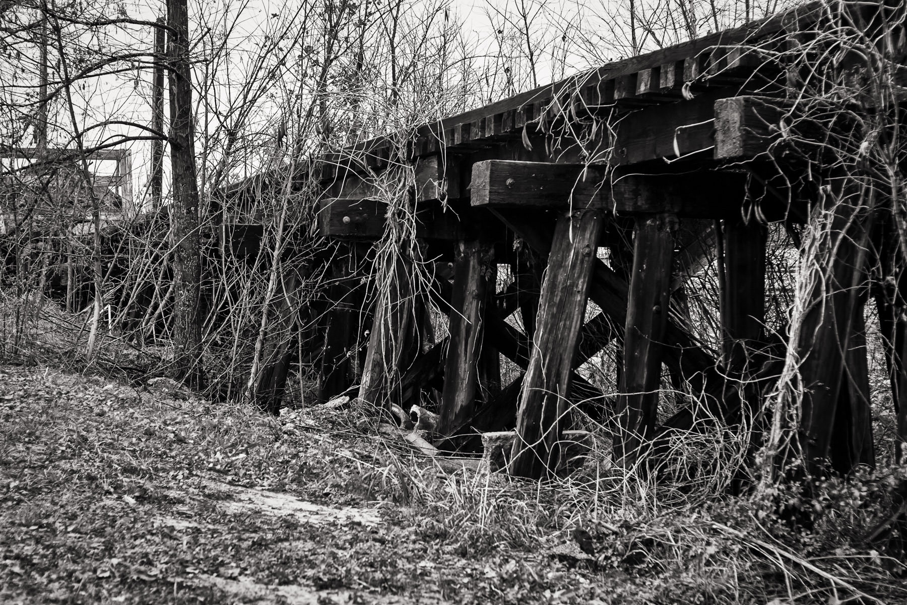 An abandoned and decaying railroad bridge in Jefferson, Texas.
