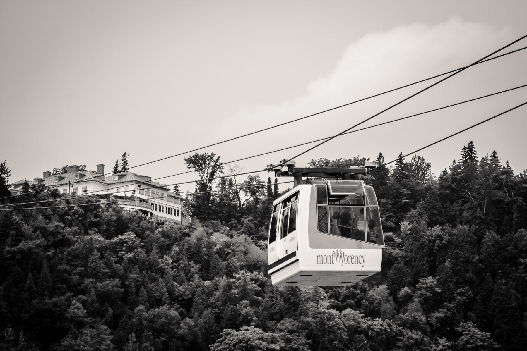A cable car carries tourists to the top of Québec's Montmorency Falls.