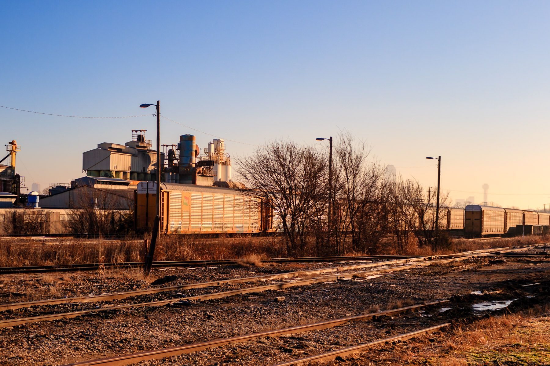 The first light of the day illuminates railcars in West Dallas.