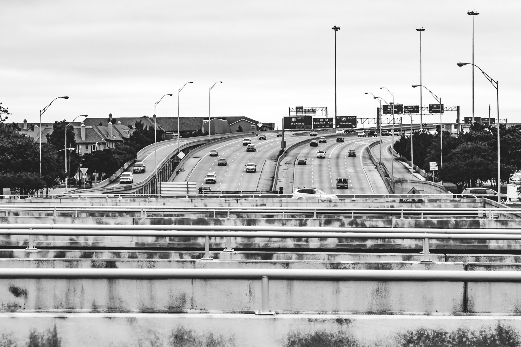 The soon-to-be- covered-over Woodall Rogers Freeway in Uptown Dallas. By 2012, these bridges over the freeway will be replaced by a five acre park while the freeway itself still passes underneath.