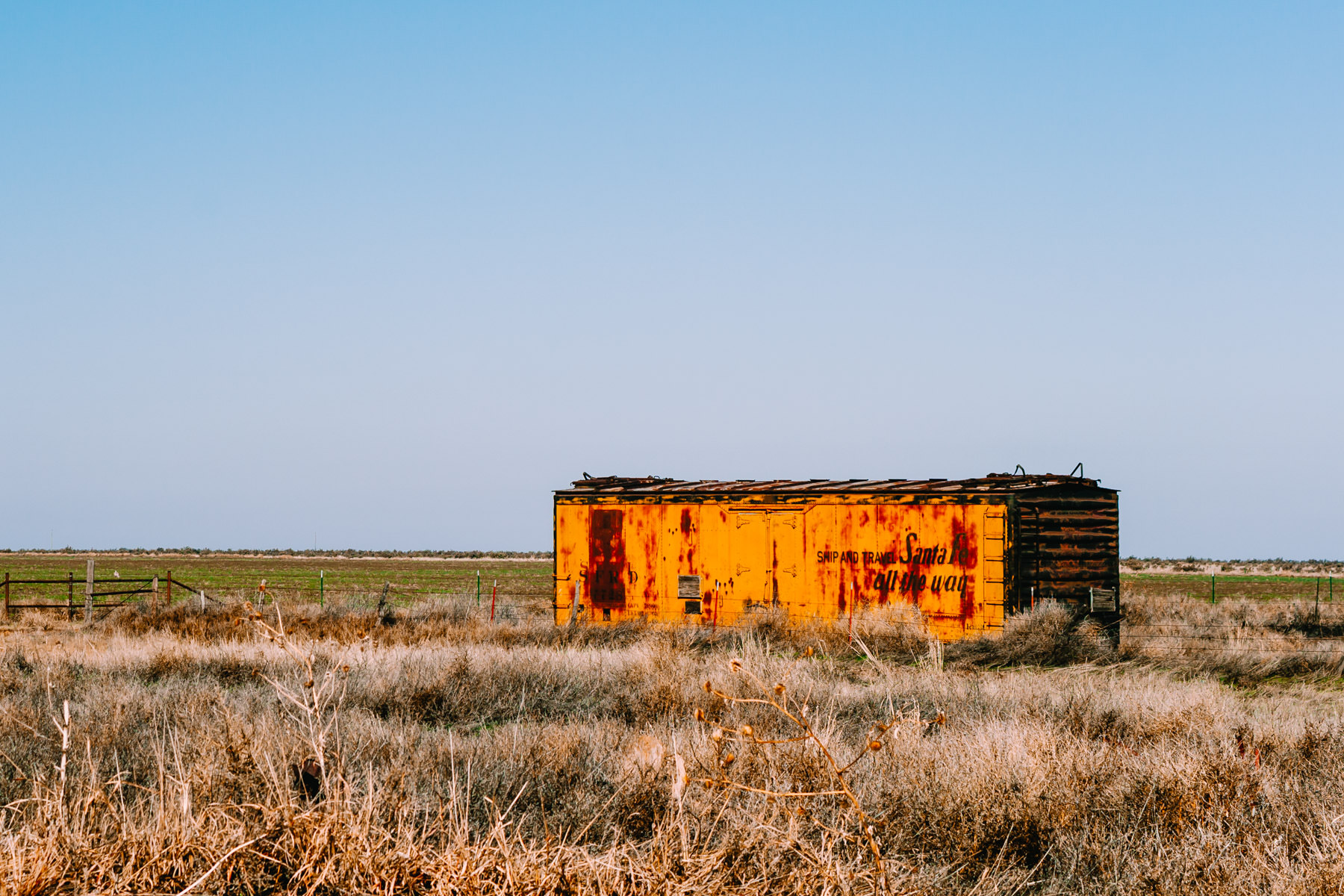An abandoned boxcar in a field somewhere in the Texas Panhandle.