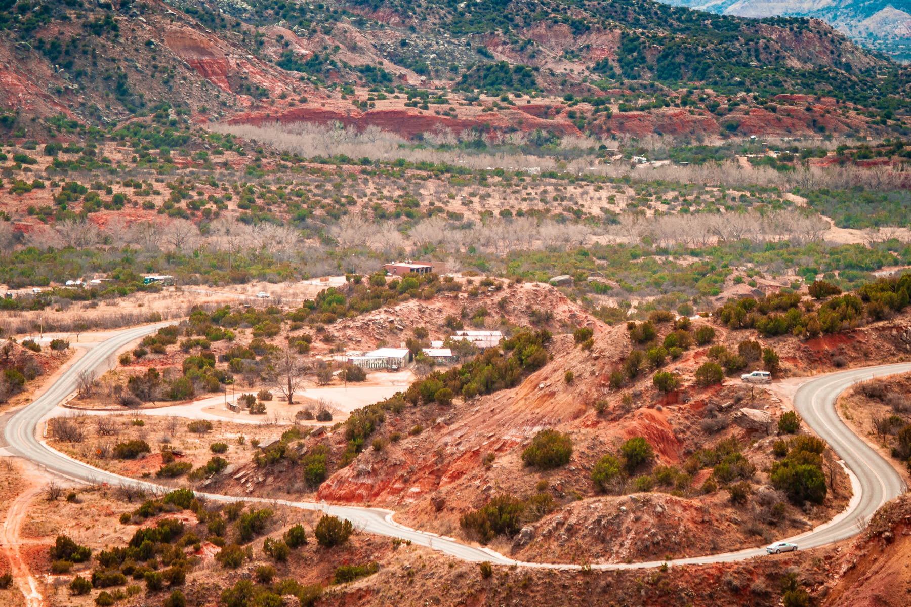 Park Road 5 descends more than 800 feet to the bottom of Palo Duro Canyon, Texas.