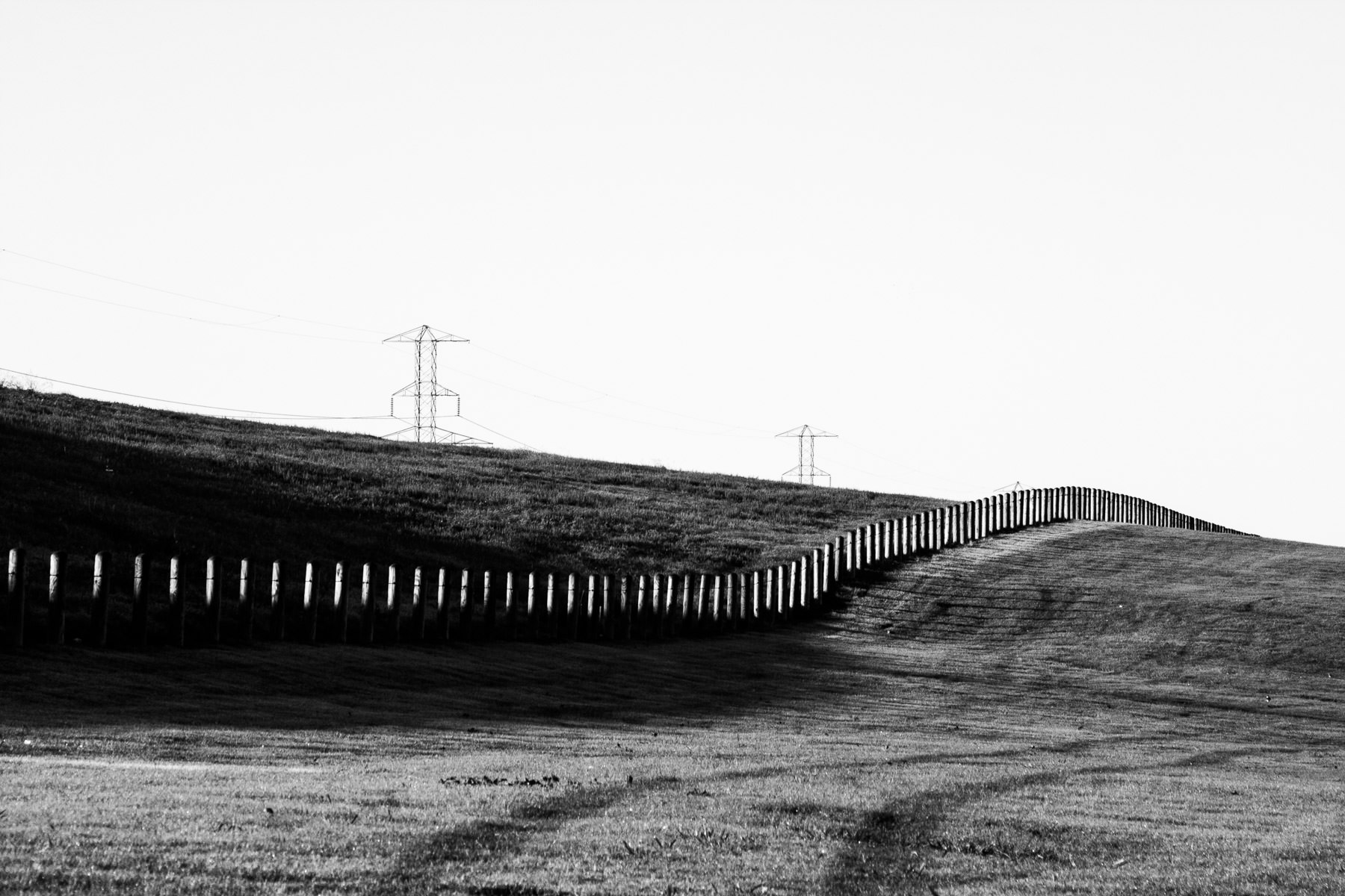 Barriers lead over a hill to the horizon in South Dallas.