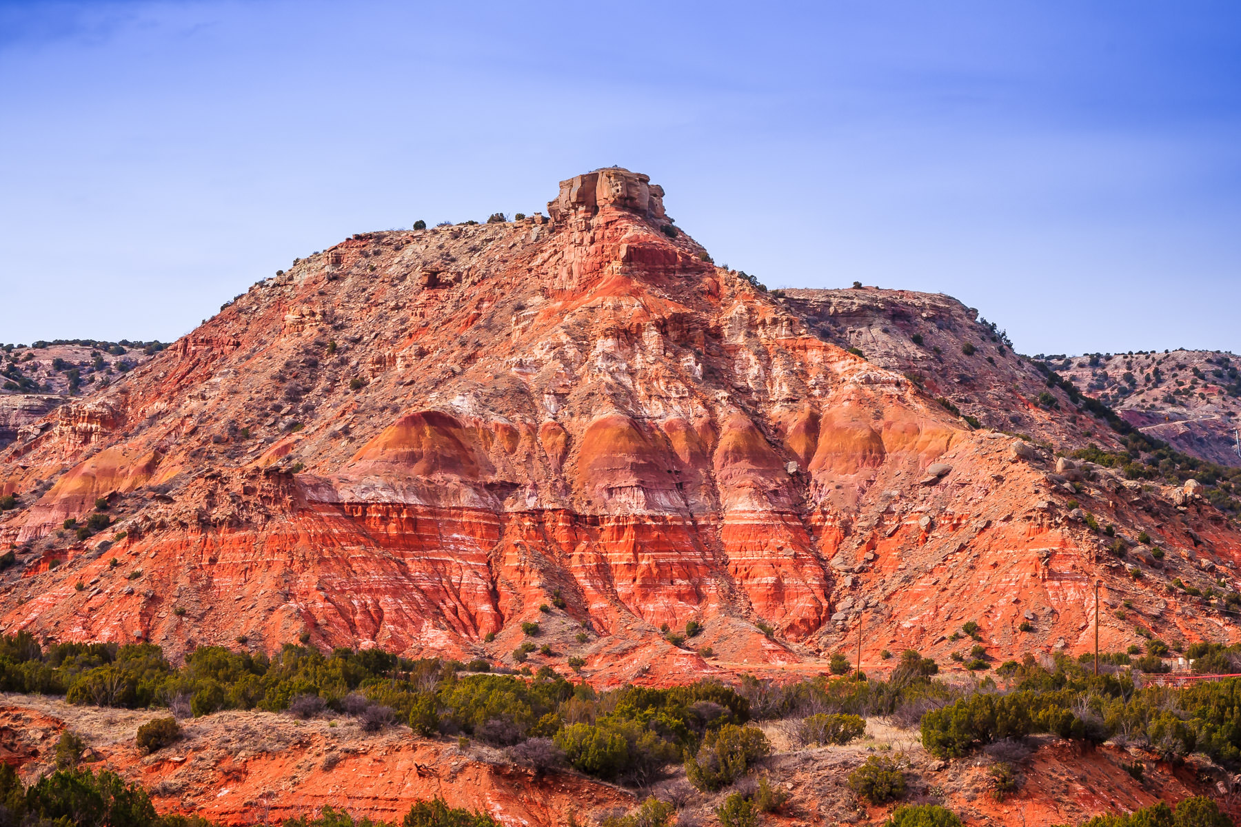 A rocky hill rises above the surrounding landscape at Palo Duro Canyon, Texas.