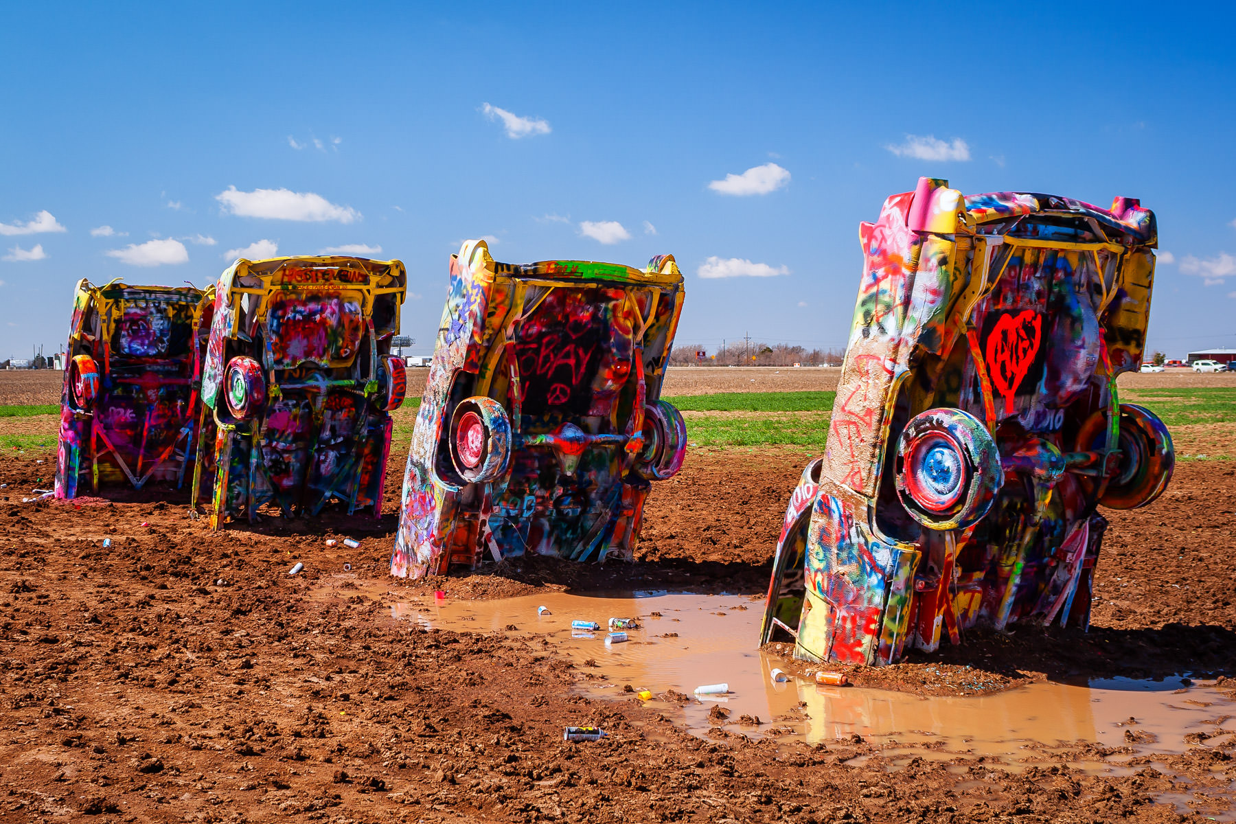 Four of the graffitied cars at Cadillac Ranch, Amarillo, Texas.